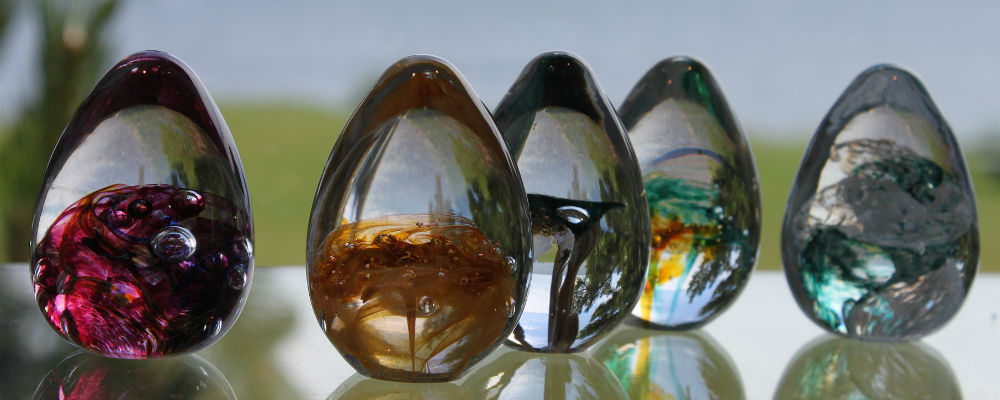 Glass ornaments made with cremation ashes