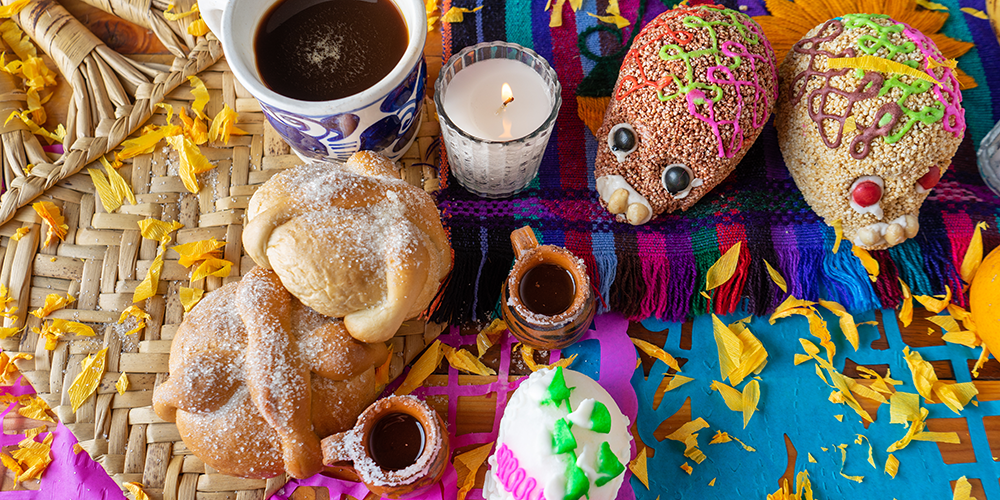 Sugar-coated pan de muertos and sugar skulls