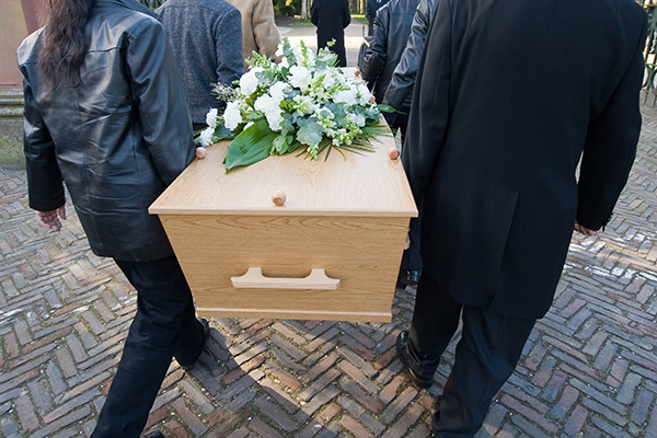 Pallbearers carrying a coffin at a funeral