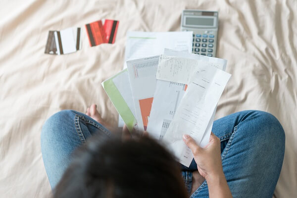 Woman struggling with funeral debt and credit card bills